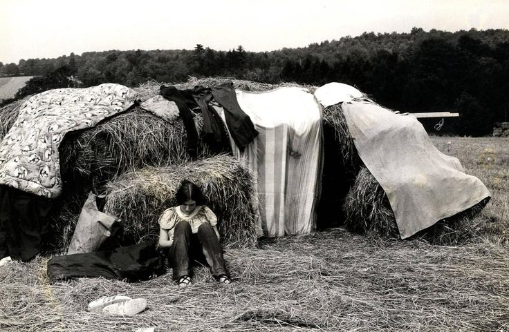 Burk Uzzle - Woodstock (girl with hay bales) For Sale at 1stdibs