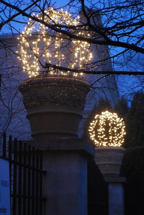 Make lighted balls with chicken wire and tiny lights- cute, cute, cute.  Great for my front door planters when there are no flowers in them.