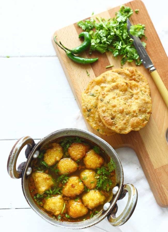 Pakodi Ki Sabzi is a delicious gluten-free, vegan yellow moong dal dumpling curry sans any onion or garlic. Super flavorsome and so simple to prepare. funfoodfrolic.com