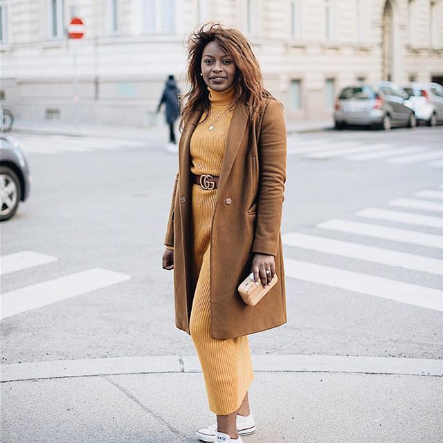 (@theurbanbrownie) mustard yellow knitted dress with a caramel woolcoat. Gucci belt and converse