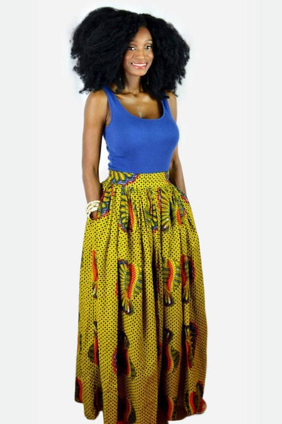 This beautiful African fabric yellow skirt makes a bold fashion statement. This handmade African skirt features a yellow Ankara print in a very full, gathered, and fully lined 43 long maxi skirt with 2 inch high waist band, invisible back zip closure and 2 side seam pockets. Ready to