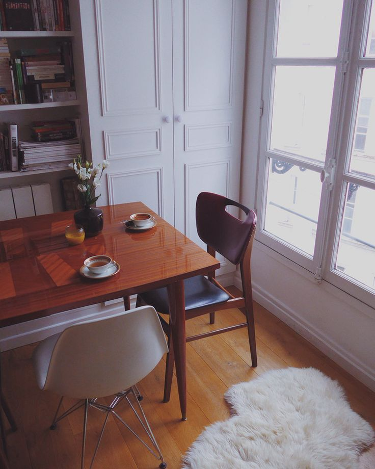 Love the mid century modern cushioned chair and the details on the cabinet doors (Paris Air BnB)