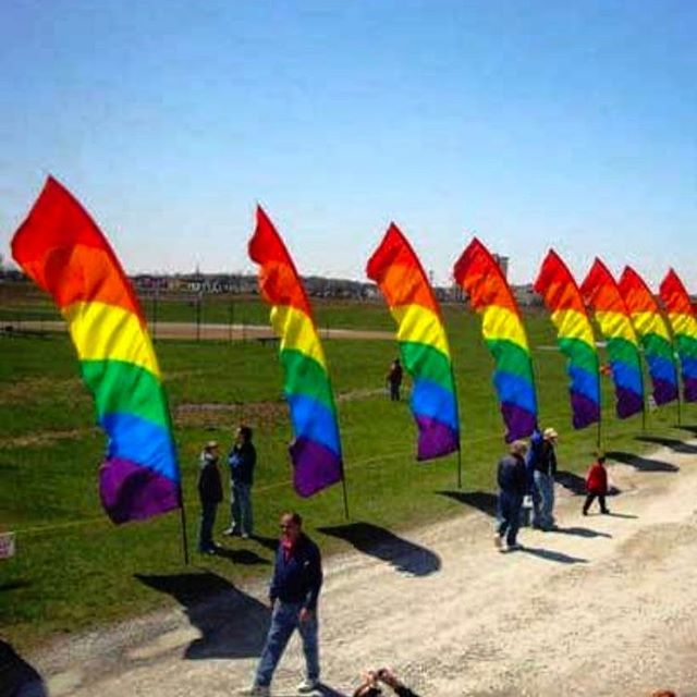 Let's paint the town... RAINBOW  . A simple and effective staple for #OutdoorEvents, our #FeatherFlags take flight, harnessing the power of #wind! We are once again beginning #production for #Pride #Festivals across the country and BEYOND at @wildchildworld. This is as important of a year as any to be involved - let us know what YOU would like to SEE and HEAR at this year's #GayPride #festivities! #EventDesign #EventDecor #ProductionDesign #PartyPlanning #Activism #Fight…