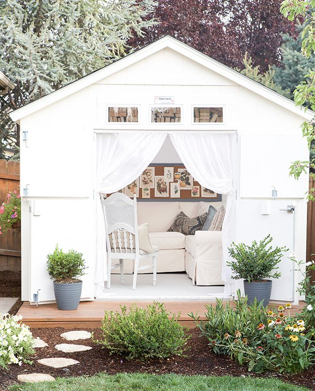 When the doors are drawn and the curtains are closed, this retreat looks like a simple white garden shed. Sure, it might be an impractical paint color, but the dreaminess makes it worth it.   - HouseBeautiful.com
