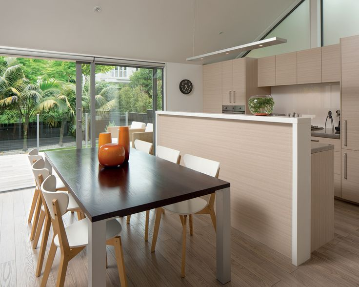 A pared-back colour scheme and material palette keep this kitchen by Rogan Nash Architects light and fresh.