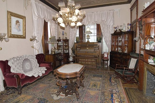The parlor with the original chandelier and table! :)