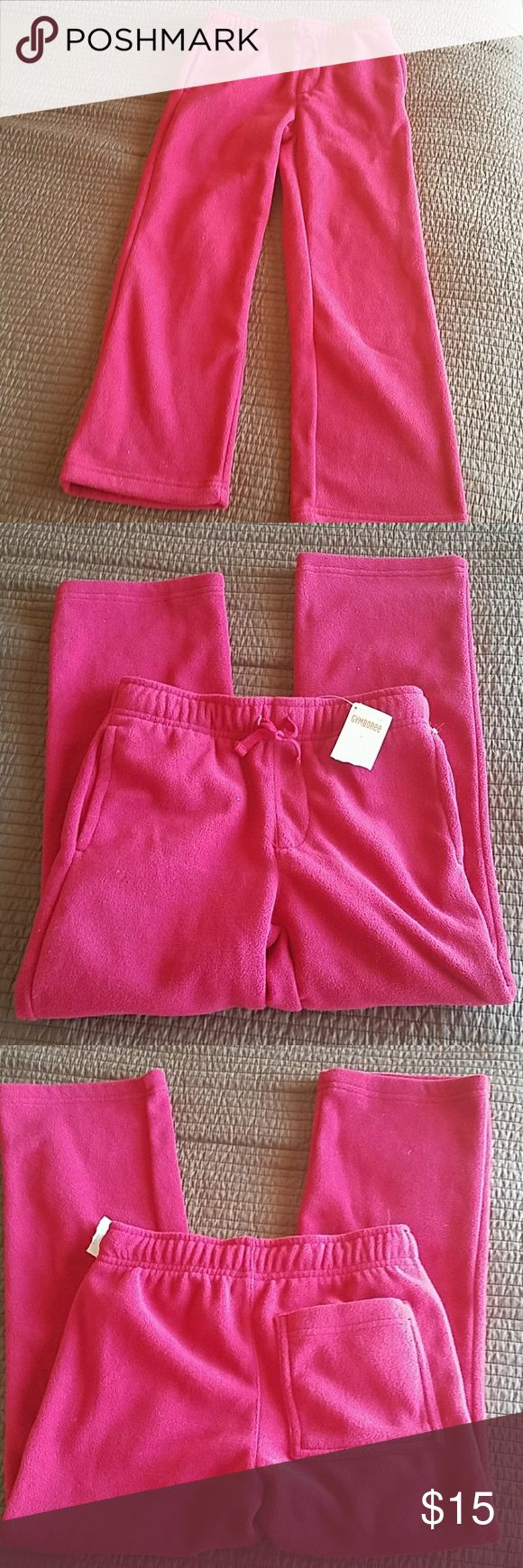 Gymboree red fleece pants sz 7 boys NWT New with tags.  Gymboree fleece pants.  Hip pickets, one back pocket, eladtic waist, straight legs.  New with tags.  Purchased in boys but deep red and styling is pretty unisex.  Smoke free / pet free home. Gymboree Bottoms Sweatpants & Joggers