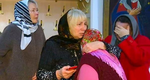 A group of women comfort each other after a memorial service in the Russian Orthodox Church in Kizlyar, Russia on Monday, following Sunday's gun attack. Photograph: RU-RTR Russian Television via AP