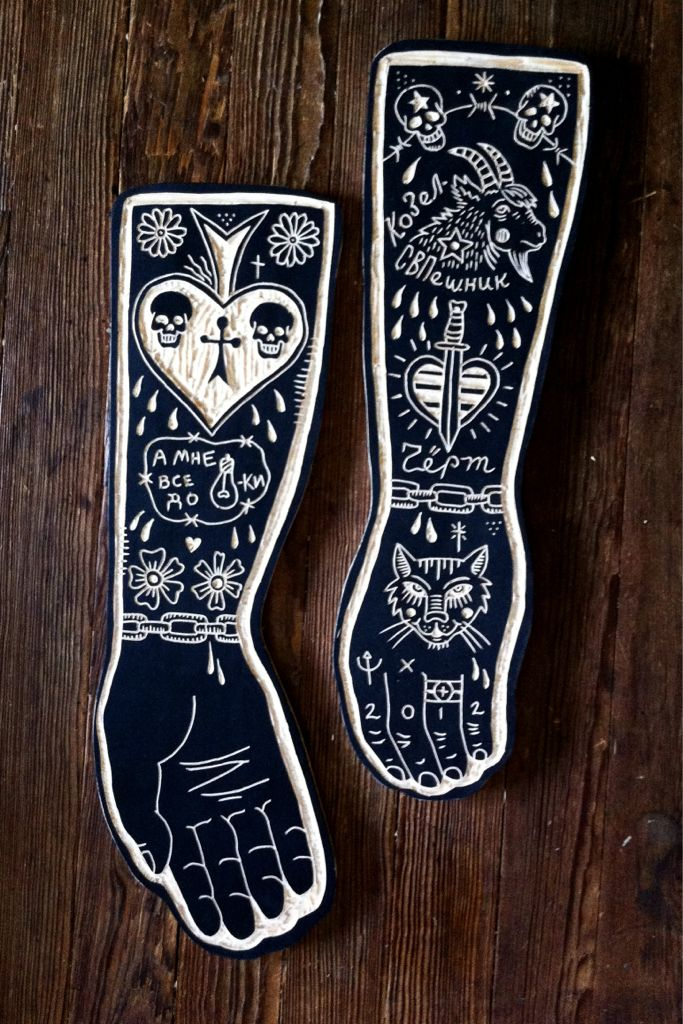 Wood carved tattooed arms by Bryn Perrott.  >>Fucking awesome