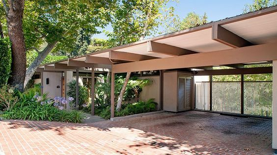 On a wooded, one-quarter-acre lot, this midcentury modern has three bedrooms, three baths, walls of glass, a sauna, a wine cellar, and a luxurious swimming pool. Asking price is $2.095 million.