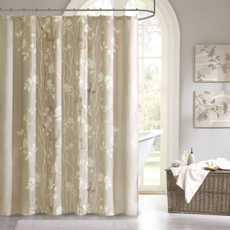 Sonora brings luxury and beauty to any bathroom. This taupe shower curtain features elegant white and brown floral tree branches with subtle yellow details.