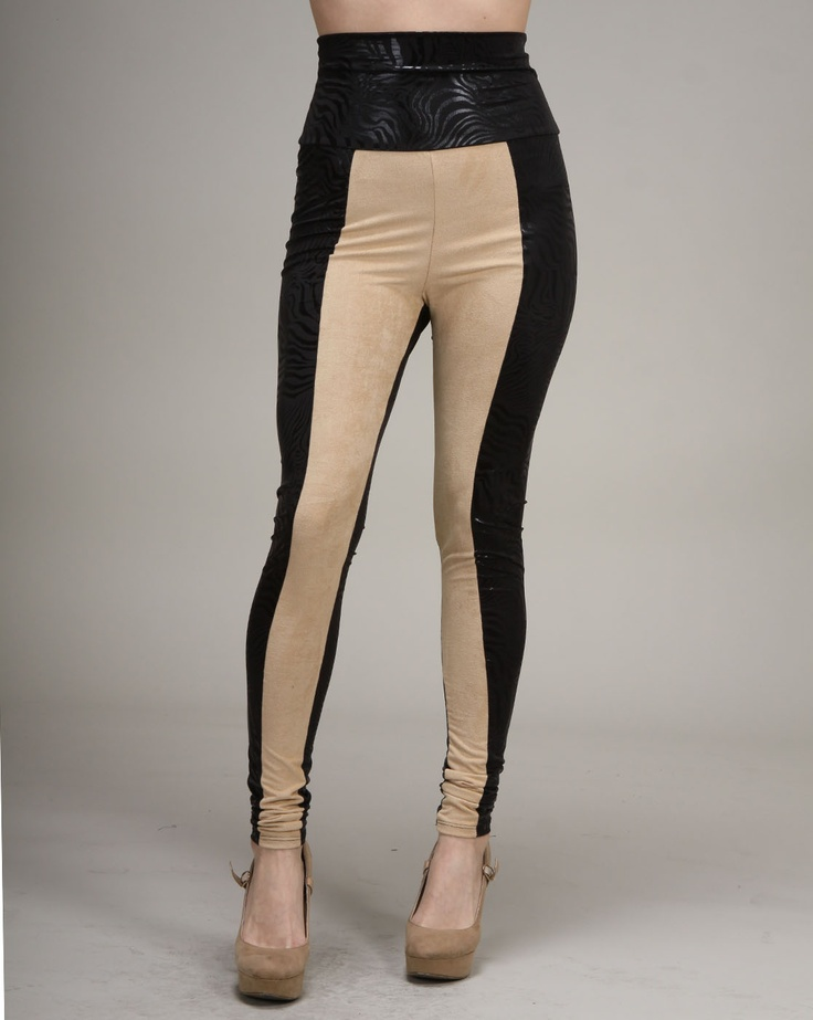 """Cheryl says: Get your hands on the """"it"""" item of the season with these beautiful color block banded leggings. The khaki front panel is offset with a black, printed panel on the back, the sides and on the high waist. Diversify your leggings easily with the addition of these high-waisted banded versions that turn drab pants into a dream."""