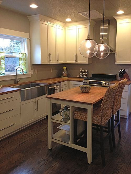 1920's bungalow kitchen remodel: butcher block countertops, custom white cabinetry, west elm pendant lighting, stainless steel farmhouse sink