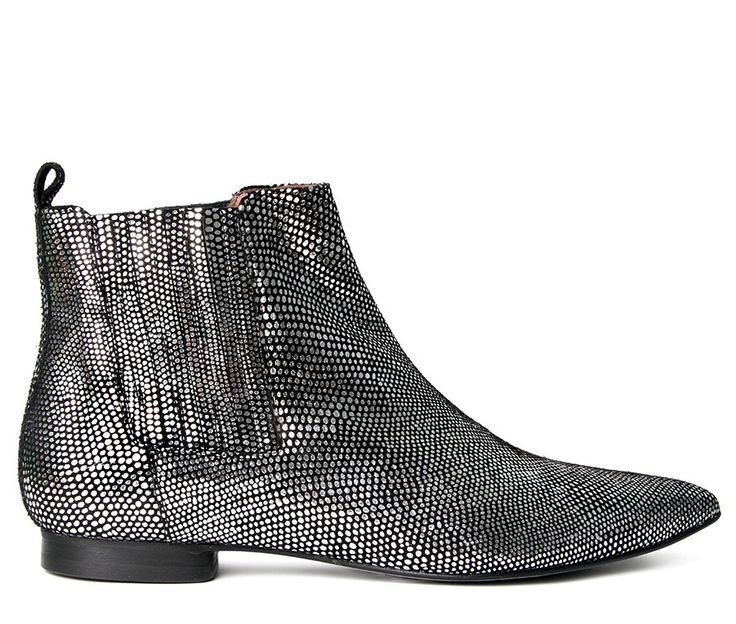 Taking the rock-chic vibe to a new level, Reine is a wardrobe must have for the fashion savvy. This heeled Chelsea boot has a stylish pointy toe, essential for the coming season, and combined with the use of lizard stamped leather,  it's been finished in an on-trend metallic.