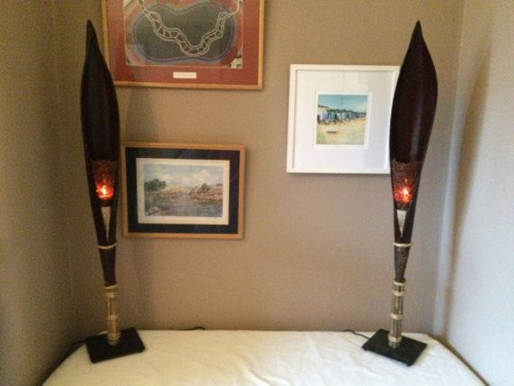 Banana Leaf Fire Torch Lamps with Flicker Bulb (sold as pair) Go to www.facebook.com/illlampya to watch a video of these lamps with flicker bulbs in action.  These lamps are handmade and come with 2 new flicker bulbs. The fire torch is mounted on a black steel base with 4 feet, tipped with rubber pads. There is an in-line on/off switch on the wire. The lamp has an E27 socket, ONLY FOR USE WITH FLICKER BULBS (MAX 4 WATTS) The lamps produce a realistic fire torch, perfect for many roo...