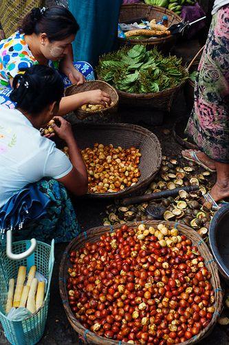 Vendors selling dogfruit at Mrauk U's morning market, Rakhine State, Myanmar