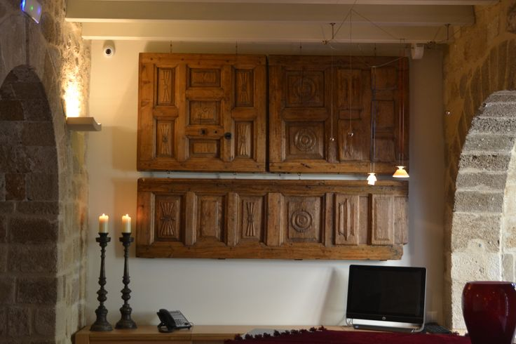 "EXCLUSIVE SUITES BOUTIQUE HOTEL. MEDIEVAL TOWN, RHODES, GREECE. - Three piece door, from a mansion (""Pyrgos"") in Mani area, Peloponese. Oak, ca 1880. Placed sideways above our desk.- kokkiniporta.com"
