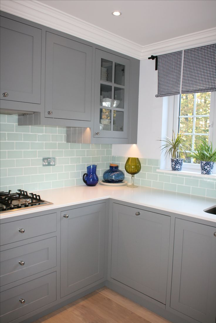 Traditional english kitchen; grey with white worktop and glass tiles