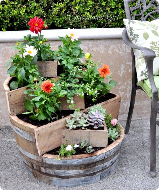 Fabulous homemade wine barrel planter.  Note to self: succulents make great decorations.
