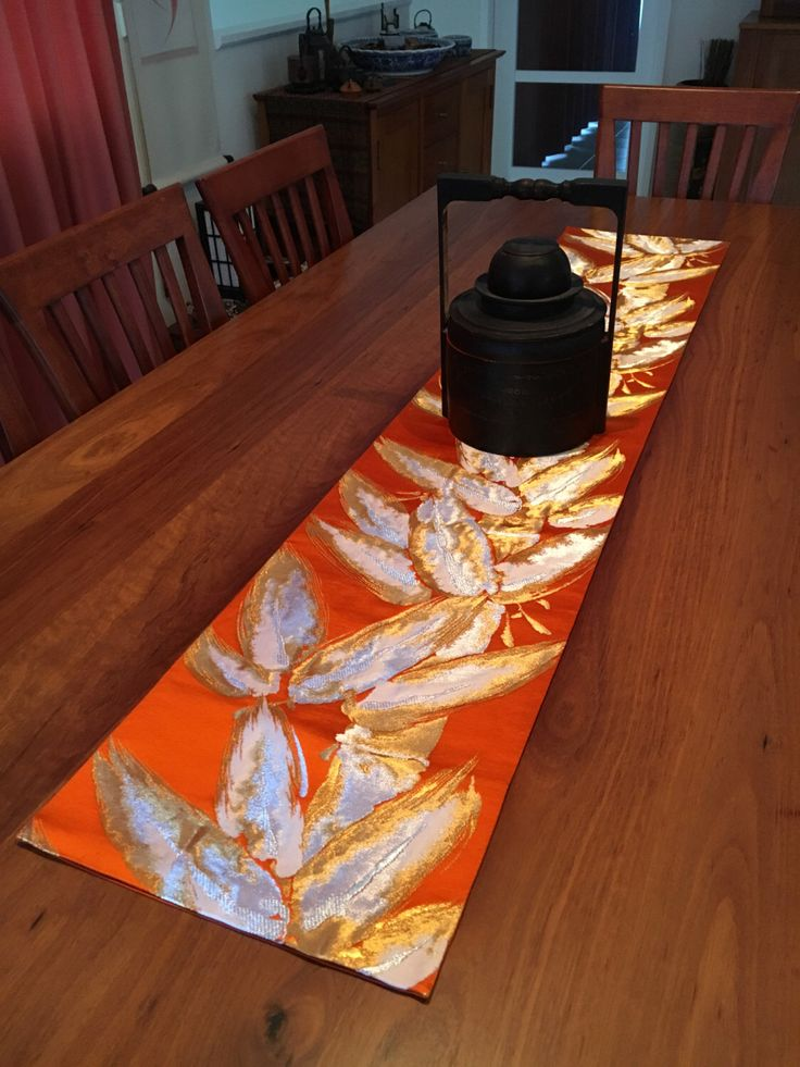 A personal favourite from my Etsy shop https://www.etsy.com/au/listing/386828576/vintage-japanese-obi-table-runner-orange
