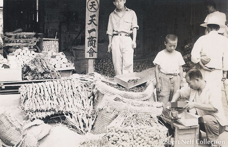 A co-op store with fish and vegetables, Chuncheon 1952.