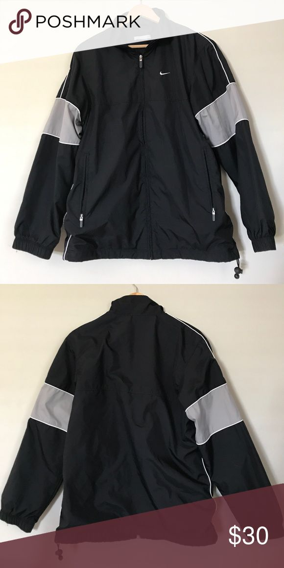 Nike running jacket Jacket is very light and great for a quick jog. Cotton/polyester lining. Very lightly used and like new! Nike Jackets & Coats Raincoats
