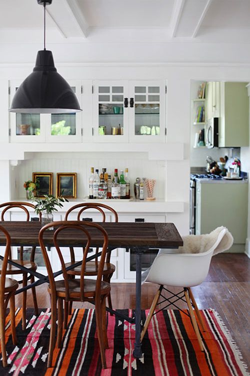 12 Kitchens & Dining Rooms Made Cozy With Kilims: Jessie Webster, photographer and blogger behind Sweet Thing, uses a Navajo-inspired antique kilim rug to add color underneath her Restoration Hardware dining table and '40s-era bentwood chairs in her Silverlake, Los Angeles home, featured on Design Sponge.