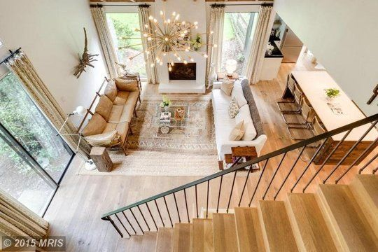 8 Tell-Tale Signs Your Home is Having a Mid Life Crisis. this home has had the bulky stairs replaced with chic modern ones. Also had the wood panelling removed. What an improvement!