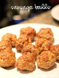 Paula Deen's sausage balls. Football Season!  1 lb cooked ground sausage 2 1/2 cups Bisquick baking mix (her recipe calls for 3, which is way too much in my opinion:) 4 cups grated sharp Cheddar 1/8 tablespoon pepper