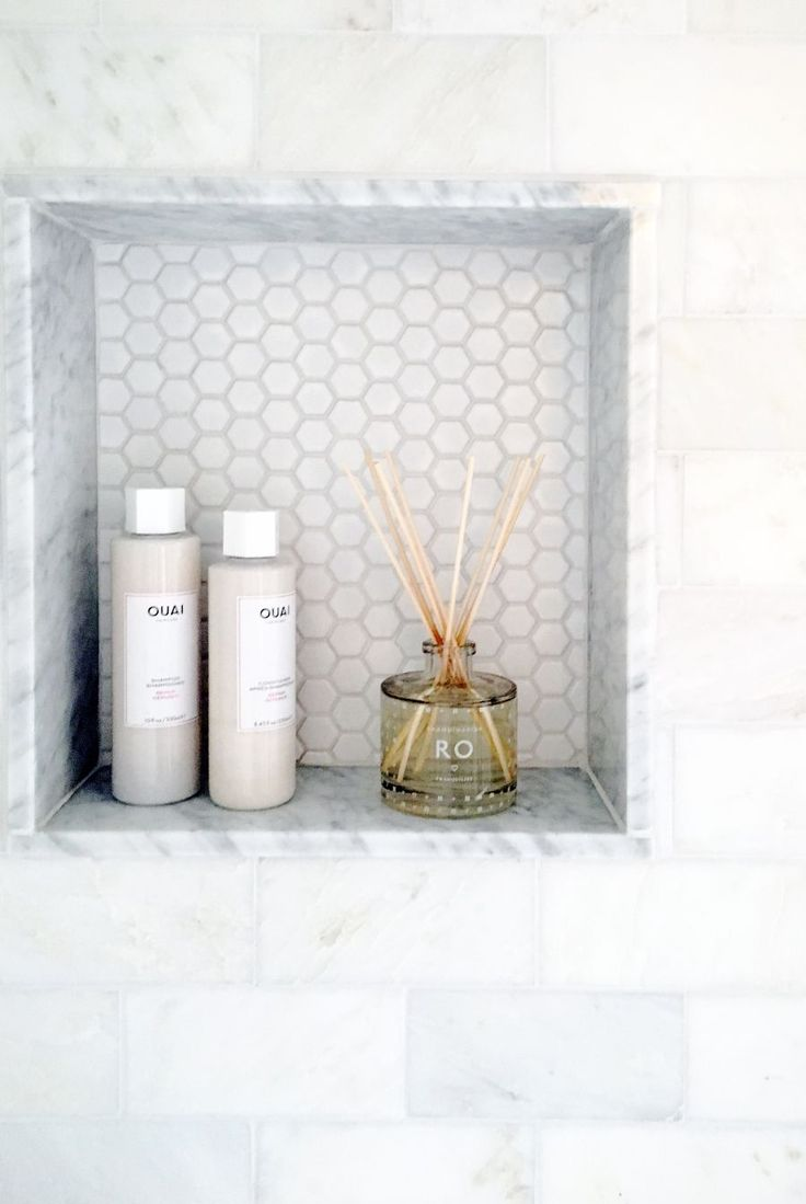 marble shower shelving cutout Photography : Snapful Photograohy | Photography : Snapful Photography Read More on SMP: http://www.stylemepretty.com/living/2016/11/02/giving-an-outdated-bathroom-a-stunning-and-timeless-makeover/