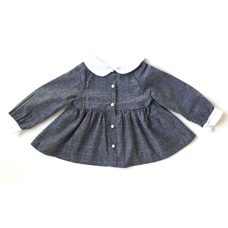 With a crisp Peter Pan collar and button-down back, this peplum top can instantly turn baby girl into a proper little lady. Crafted with dobby fabric (a flat we