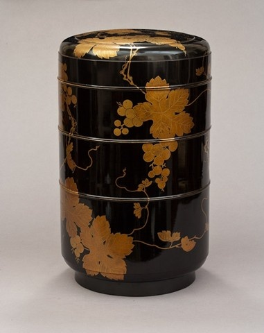 Early 19th century Japanese black lacquer three-section round storage box with gold grapevine decoration and red lacquer interior