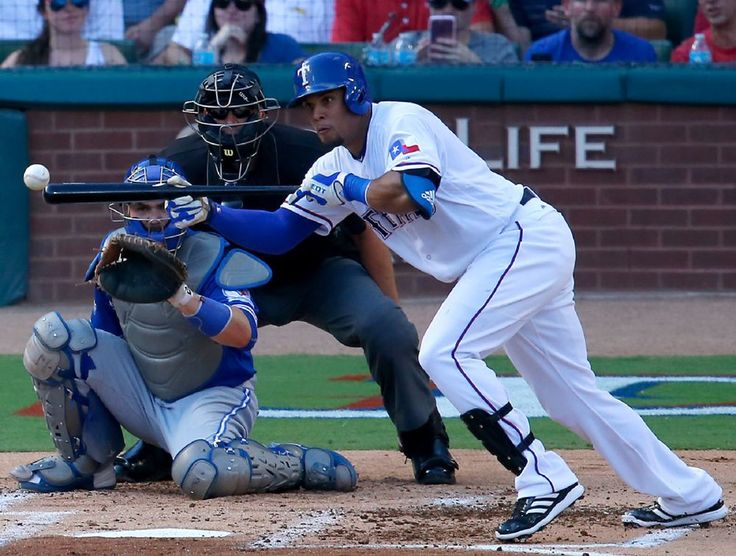 Carlos Gomez bunts during the first inning of ALDS Game 1 at Globe Life Park on Thursday, Oct. 6, 2016. (Jae S. Lee/The Dallas Morning News)