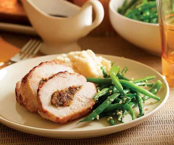Dried Apricot & Date Stuffed Turkey Breast with Marsala Glaze - A boneless turkey breast stuffed with sweet, nutty flavors is perfect for Sunday dinner or even special enough for a small Thanksgiving or Christmas dinner. http://www.finecooking.com/recipe/stuffed-turkey-breast-marsala-glaze.aspx