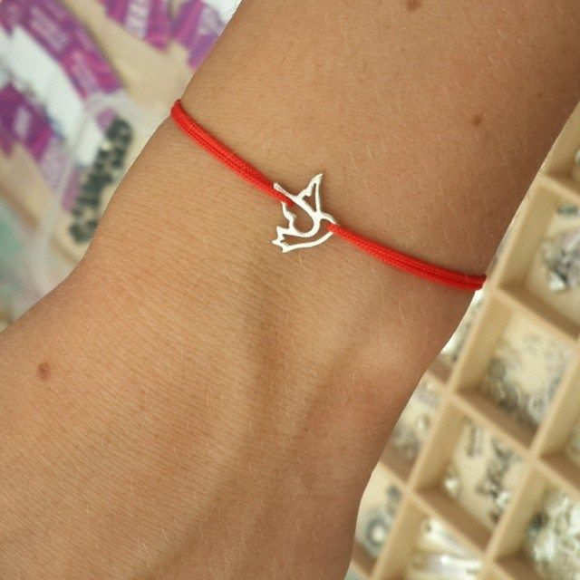 Cord bracelet with a sterling silver dove charm.Dove, usually white, is used as a symbol of love and peace, sacrifice and devotion.Also dove is a symbol of motherhood as they produce their own milk.As a love symbol it means love of a soul, unconditional love.
