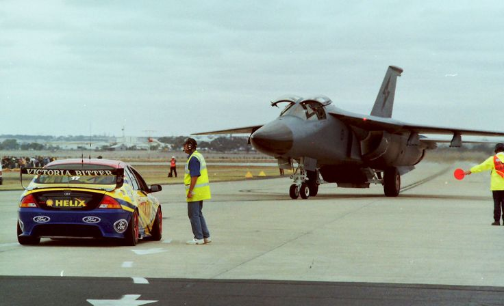 Not very often you get a V8 Supercar and an RAAF F-111 in the same place but we did at one of the airshows  Scanned negative from a 35mm Canon AE-1