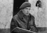 Alex Colville pictured as a war artist while a young man.