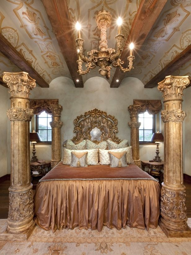 Opulent Old World Bedroom With Marble Columns and Ornate Headboard and Chandelier
