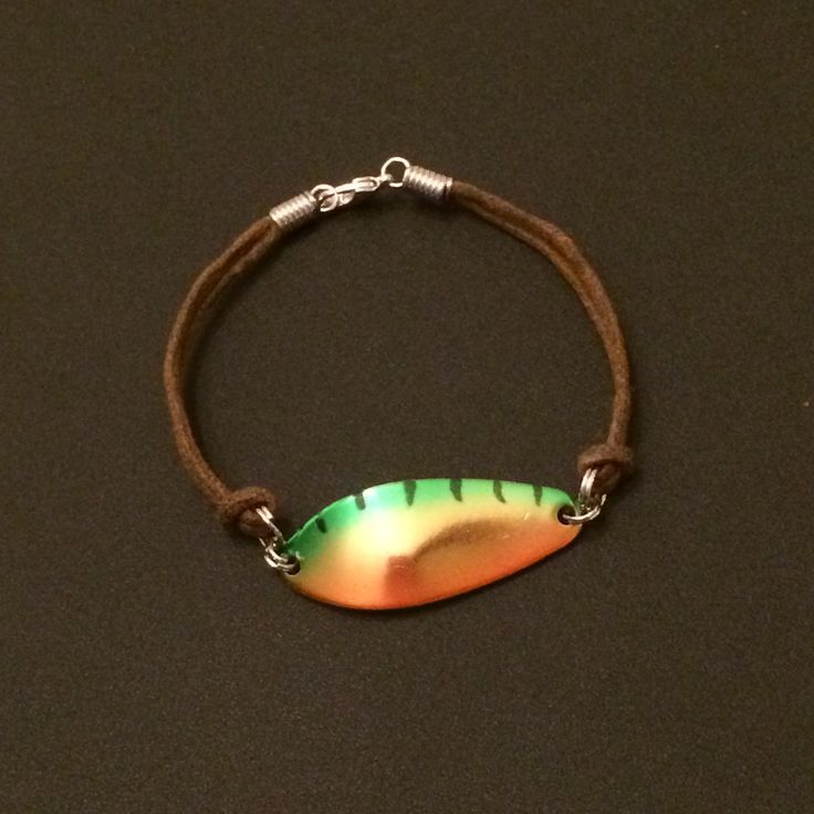 LuckyLures Fishing Bracelet uses a real fishing lure (spoon) on a brown leather ...