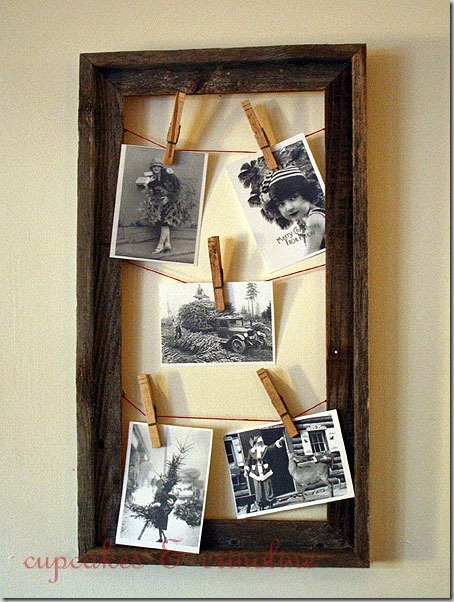 Vintage Christmas black & whites hung by clothespins on baker's twine in an open frame