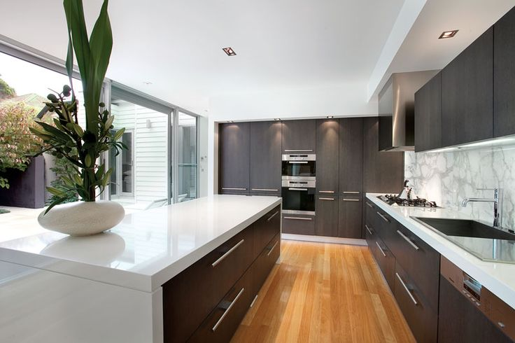 A sleek Miele and stone Bontempi kitchen add to the stylish ambience of this contemporary home