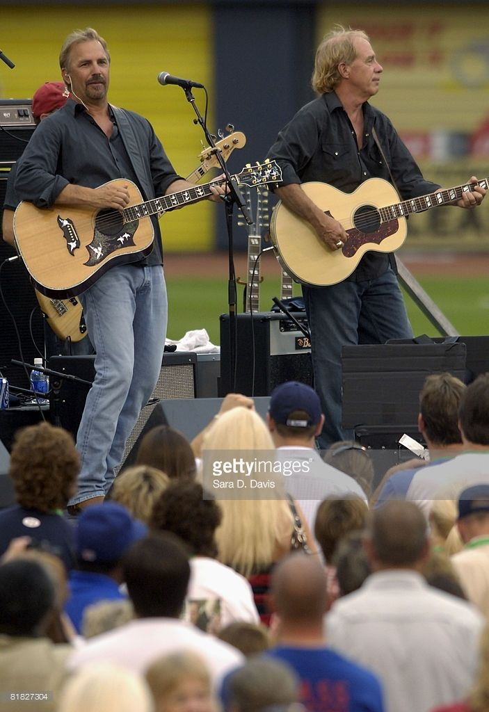 Kevin Costner (L) performs with his band Modern West at a July Fourth celebration at the Durham Bulls Athletic Park in Durham, North Carolina. The concert marked the 20th anniversary of Costner's baseball movie 'Bull Durham,' filmed in Durham.