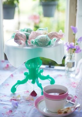 Freda Cake Stand £23.00    Wonderfully easy to assemble in a matter of moments and available in a vibrant pink, blue or green.     The cake tier is separate from the stand so it easily slots into your cake tin to provide a much-needed extra shelf – Those beautifully decorated cakes and muffins will never be flattened again.      Simply lift the shelf straight out of the tin and slot the pedestals into the tier notches and hey presto… a delightful cake stand, ready to go.