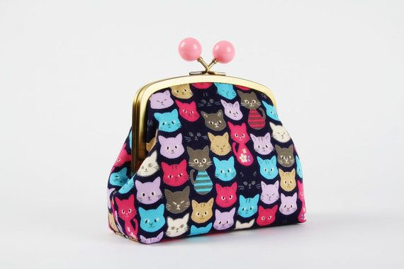 Metal frame clutch bag  Colorful cats on navy blue  by octopurse, €24.90