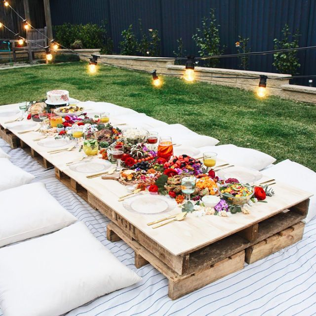 Why not throw a picnic-style party? What looks like a fancy set-up will only take you minutes to put together. Use some crates as a table and set out a blanket and some pillows and everyone will be nice and cozy while they eat their dinner.