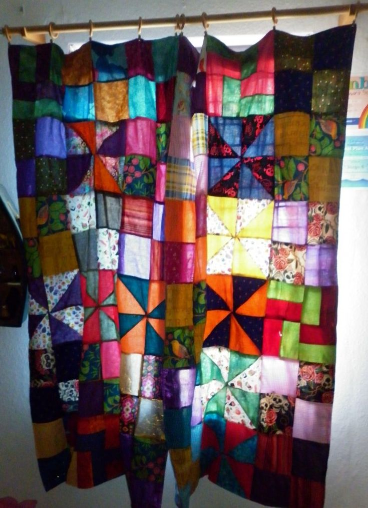 Patchwork curtains from remnants with pinwheel sections :) Separate square sections all joined together... might try this as an alternative to doing it in strips