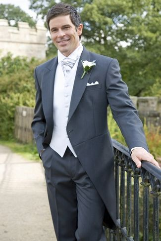 Sean wants tuxes with coat tails (which I think is fab vintage for Mackinac Island) and I think dark gray is a good color for an outdoor wedding. He isn't fond of ties because he has trouble folding them. Do you have to tie a cravat?