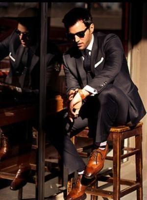 black suit saddle brown shoes