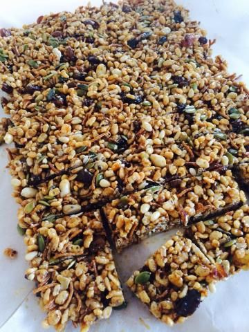 These sugar-free chia, pepita and Rice Bubble slice looks naughty, it tastes naughty, but it is a low GI, high protein burst that kids love. With no added refined sugar it is great for kids and grown up lunch boxes too. It is also super quick. You can make it while you are waiting for dinner to cook for tomorrow's lunch boxes!