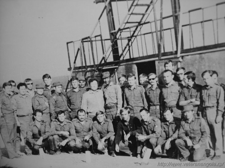 """Cuban and Soviet officers pose together at Camp """"ZAPU Bohm"""" in Luena, Angola. Photograph taken sometime during 1979."""
